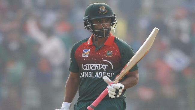 tamim acknowledges the crowd after his century